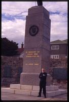 Jack Child standing next to 1982 Monument