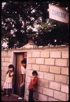 "Children standing by ""comedor"" near Yalí"