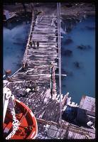 Aerial view of television crew, bagpipe player, and Grytviken dock from World Discoverer