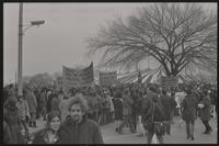 Alternate view of a mass of protesters outside of the counter-inaugural tent on the Mall near Independence Ave SW and 15th St SW, demonstrating against Nixon's inauguration and the Vietnam War, 19 January 1969