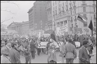 Alternate view of students behind the Southern Student Organizing Committee banner reaching 14th St NW and Pennsylvania Ave NW during a protest march against Nixon's inauguration and the Vietnam War, 19 January 1969