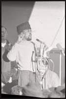 An African-American man gives a speech during a rally for protesters marching against Nixon's inauguration and the Vietnam War, 19 January 1969