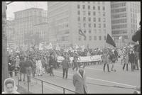 Alternate view of a march led by the Southern Students Organizing Committee passing down Pennsylvania Ave NW, protesting Nixon's inauguration and the Vietnam War, 19 January 1969