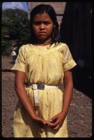 A young girl wearing a yellow dress to attend a Good Friday procession, Managua, Nicaragua