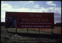View of Miliciano billboard in field