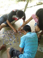 Aerial view of children putting together a puzzle at Raquel's house in El Plátano, Panama