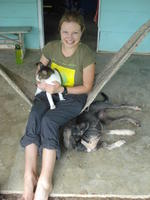 Alternate view of Rachel Teter posing in a hammock with a cat and dog, El Plátano, Panama
