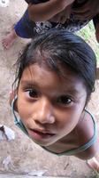 A young girls looks into the camera during Rachel Teter's visit to Bocas del Toro, Panama