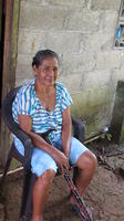 Abuela Chiru sitting in a chair with walking cane in El Plátano, Panama