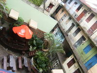 Aerial view of apartment building and patio seating in the Casco Viejo district of Panama City, Panama