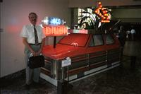 "Man posing in front of ""goodeats"" car at Yugo Next exhibition in Union Station, Washington, D.C."