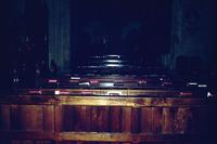 Bibles resting on pews inside of a church