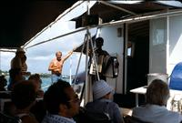 An accordionist entertains passengers on the deck of a boat, Bermuda