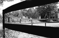 Alternate view of wooden fence around paddock at Meadowbrook Stables in Chevy Chase, Maryland