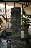 Man posing in front of Moai head at Yugo Next exhibition in Union Station, Washington, D.C.