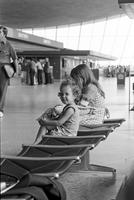 Young girls sitting in Washington Dulles International Airport, Dulles, Virginia
