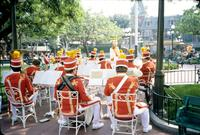 A band sits and warms up in Disneyland, Anaheim, California